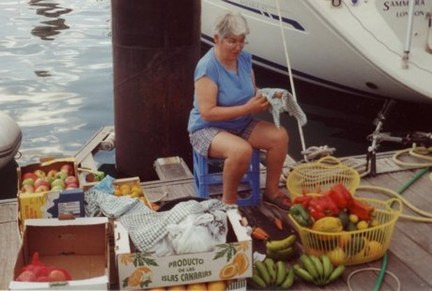Ann cleaning all the fruit before loading